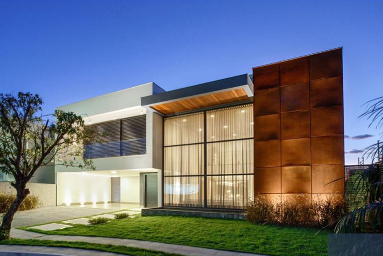 Tend ncias de fachadas de casa para 2018 casas kurten for Materiais para fachadas de casas modernas